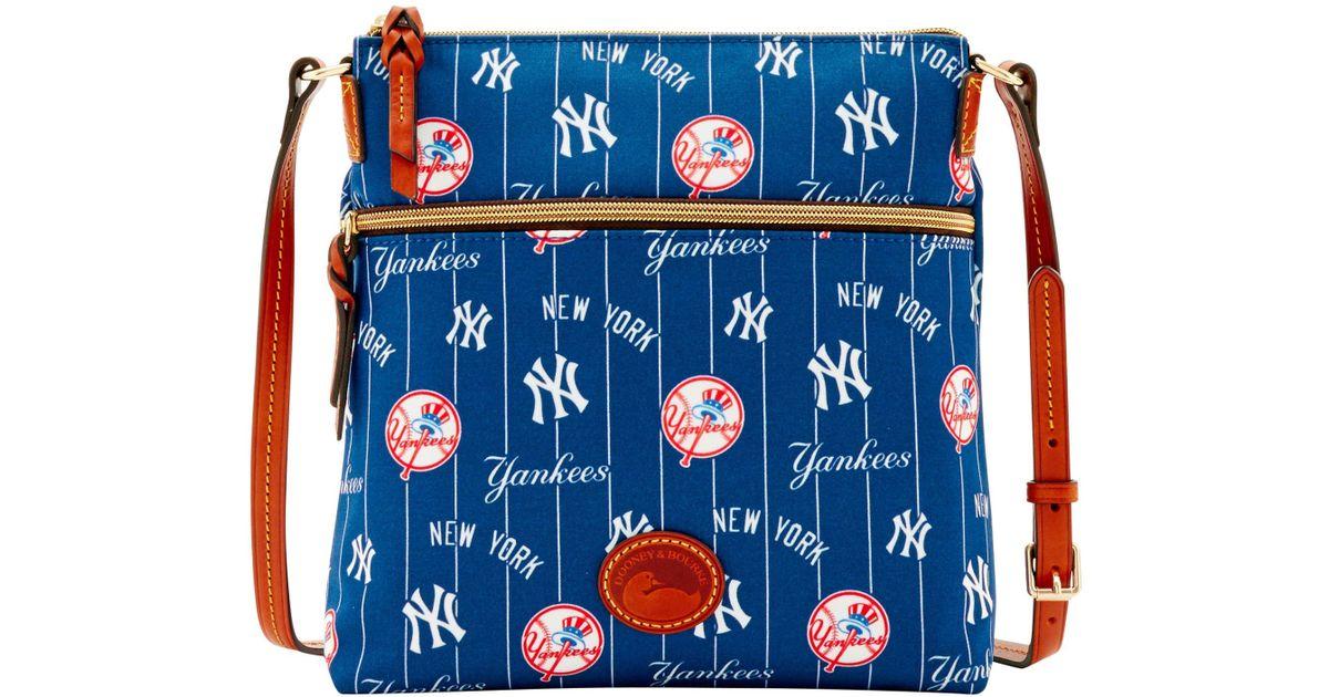 1bb04f3a6d50 Lyst - Dooney   Bourke Mlb Yankees Crossbody in Blue