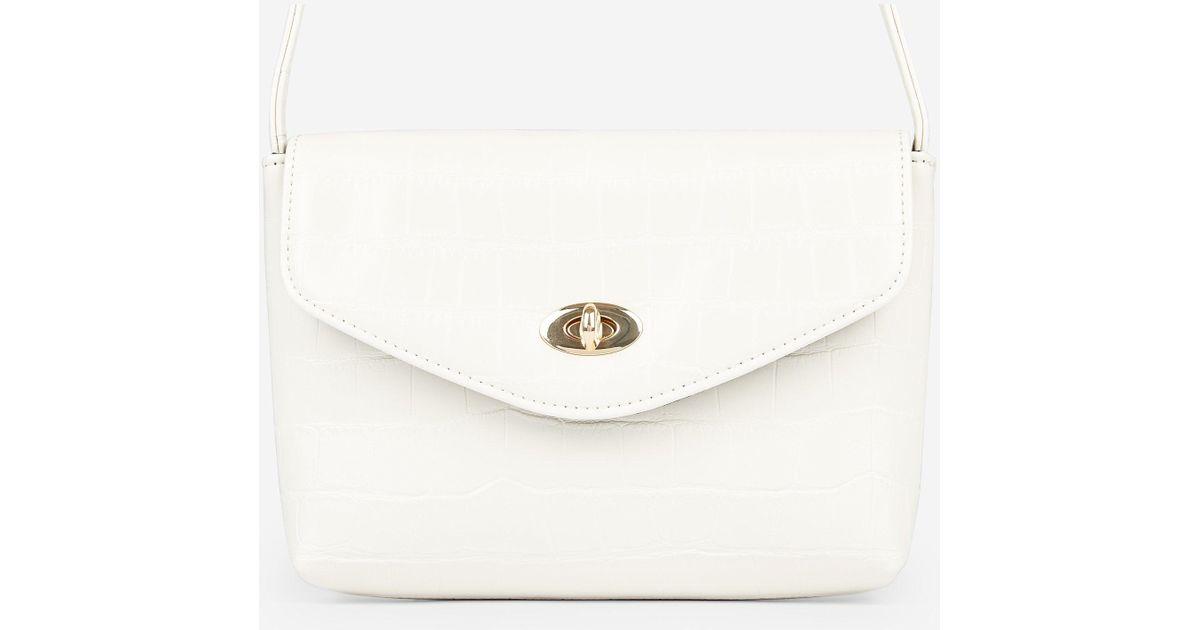 015c75d0c9b Dorothy Perkins - Natural Cream Crocodile Design Twistlock Cross Body Bag -  Lyst