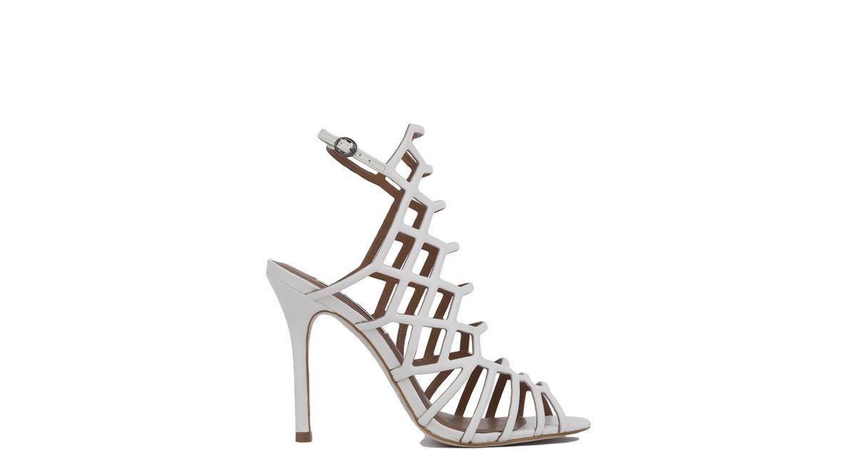 c1c28dd25b8 Steve Madden - White Slithur Caged Heeled Sandals - Lyst