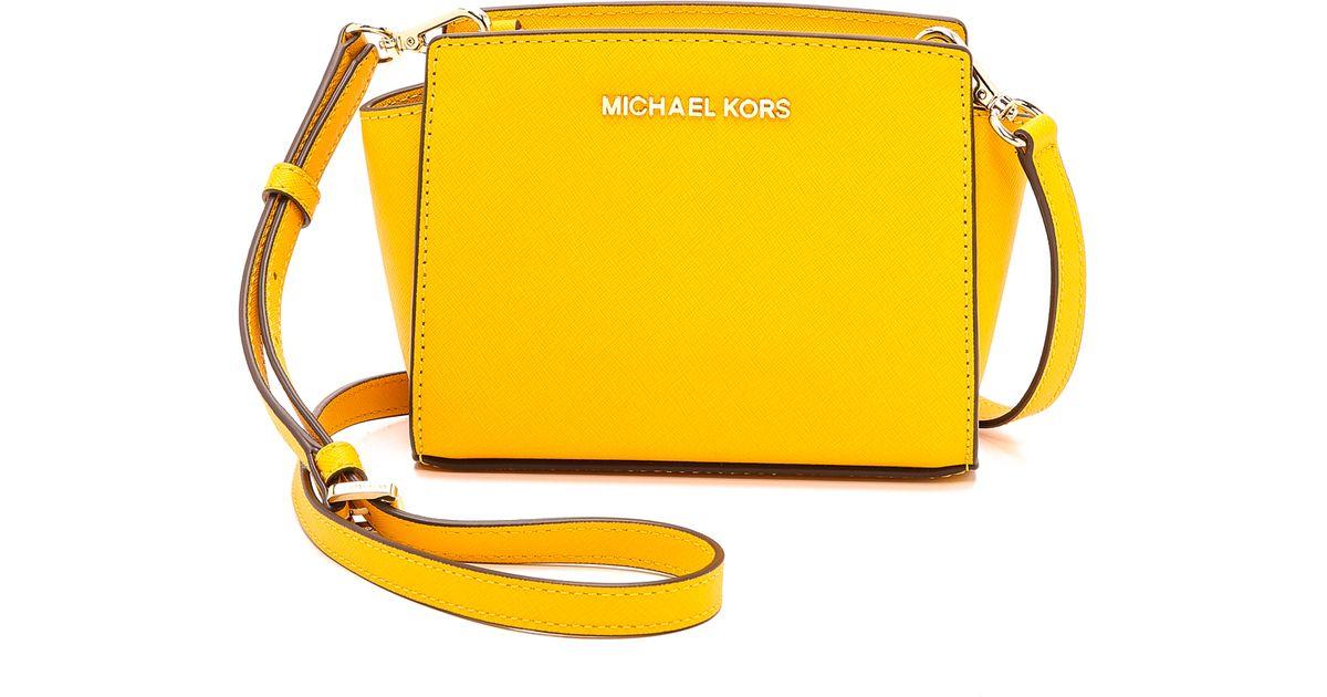 51076375139e ... germany lyst michael michael kors selma mini messenger bag chili in  yellow 2c420 117ec