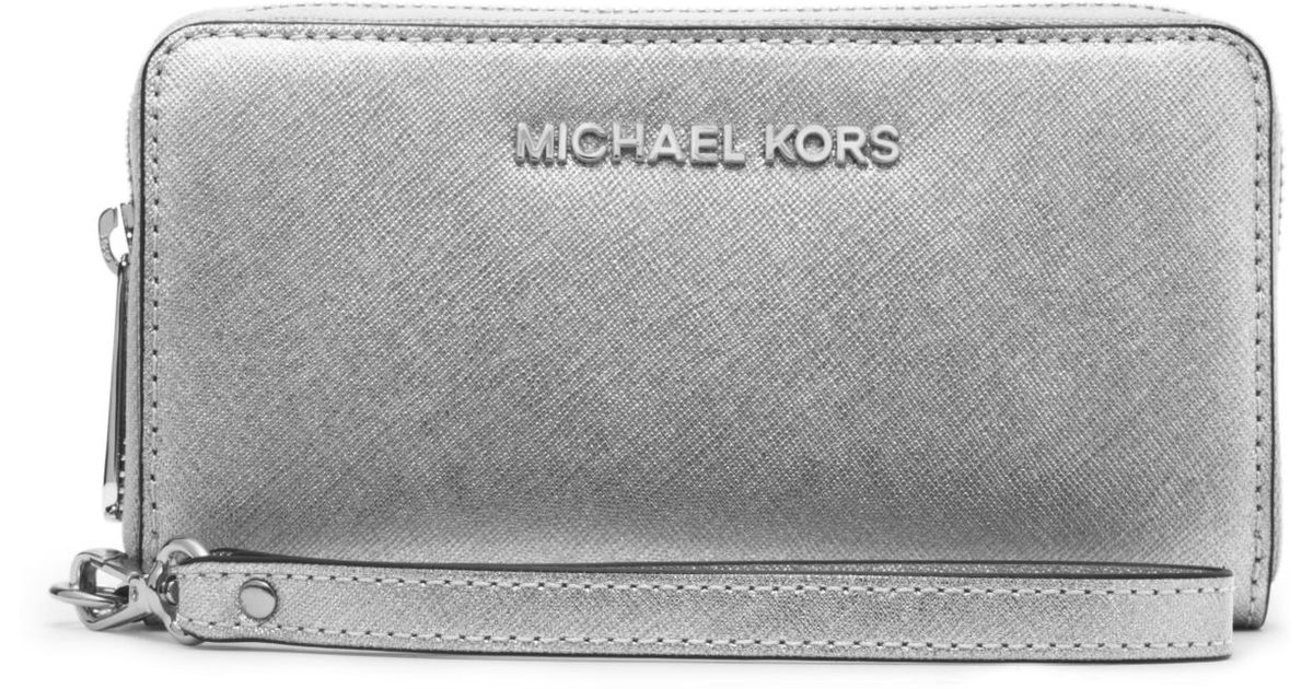 dd24dfd572ec Lyst - Michael Kors Jet Set Travel Large Metallic Leather Smartphone  Wristlet in Metallic