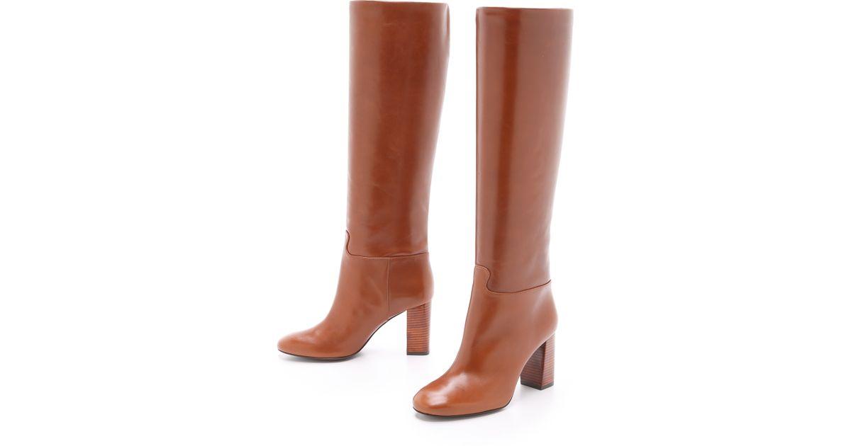 76cc99861b7 Lyst - Tory Burch Devon Tall Boots - Black in Brown