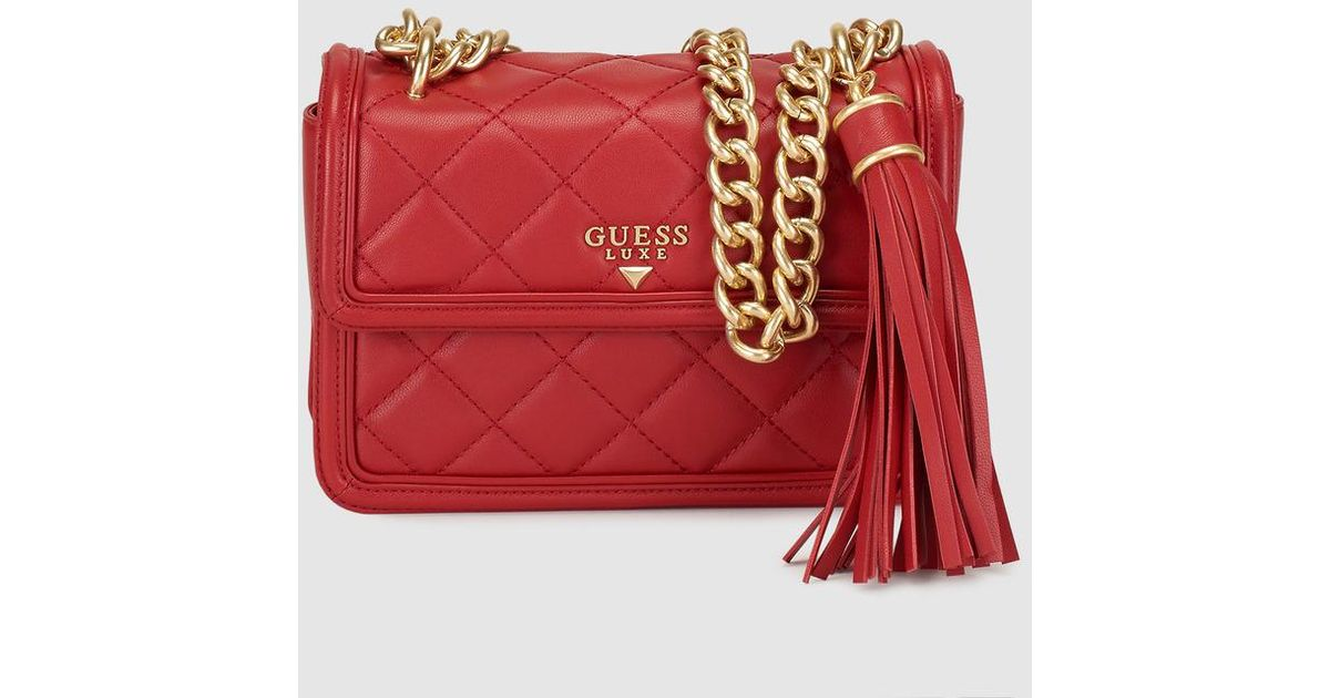 87c452c641d4 Lyst - Guess Wo Small Quilted Red Leather Crossbody Bag in Red