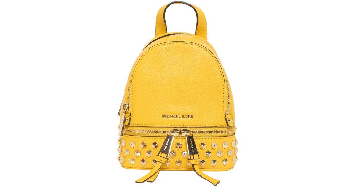 ca275a4c3b MICHAEL Michael Kors Zaino Mini Rhea In Pelle Con Borchie in Yellow - Lyst