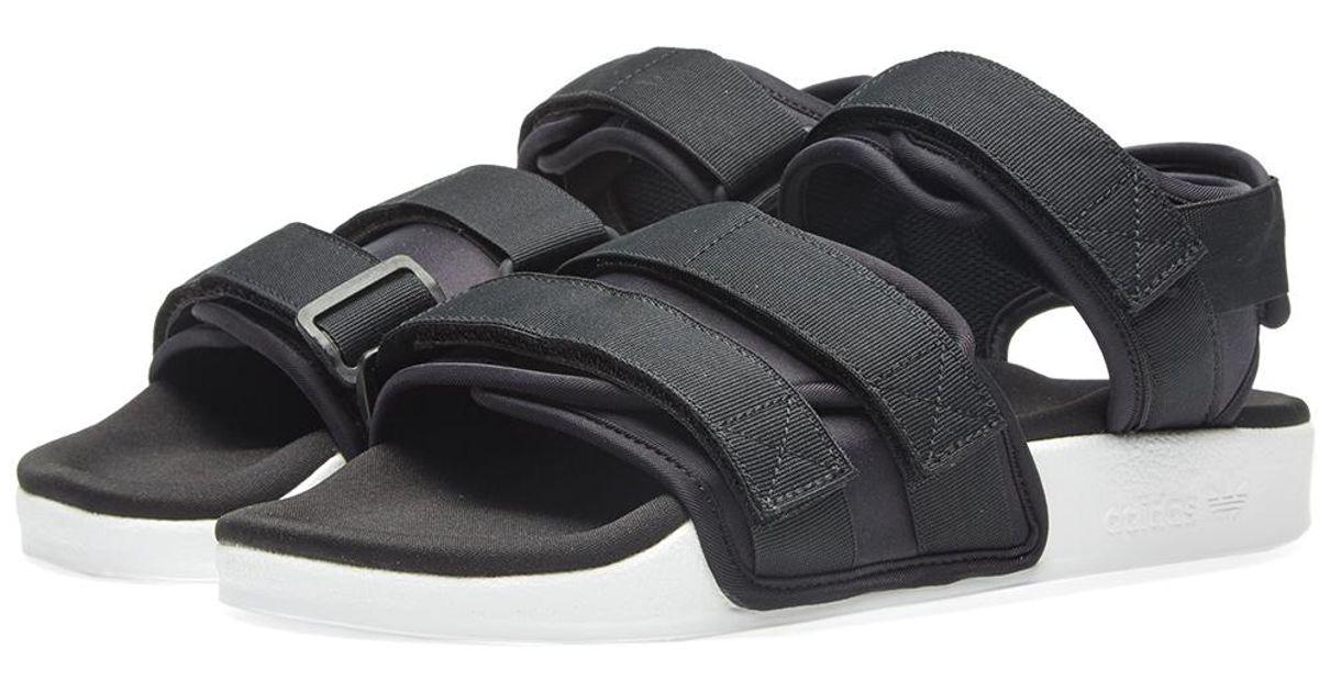 acb17dc2 adidas Women's Adilette Sandal W in Black - Lyst