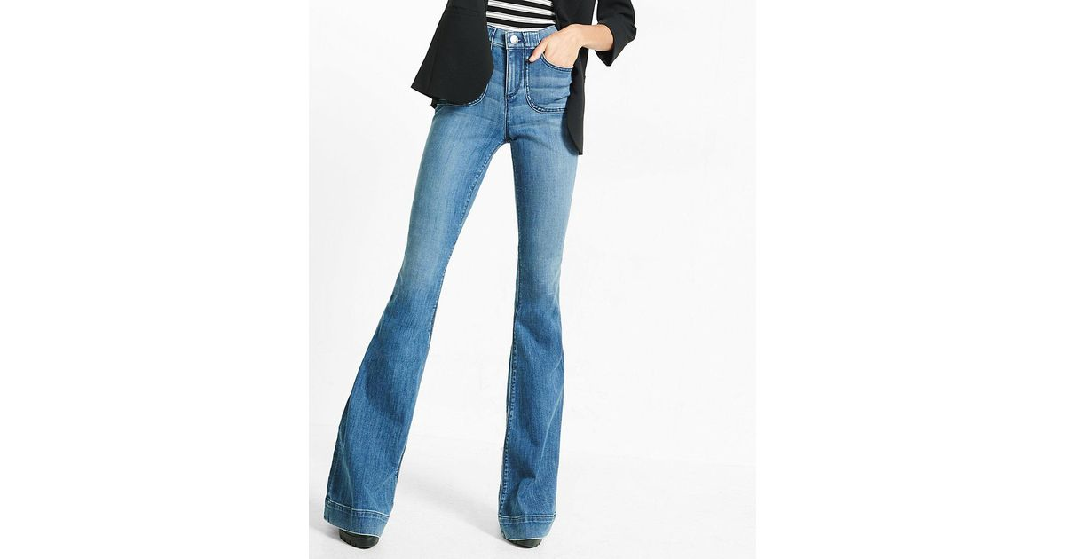 Lyst express high waisted bell flare jeans in blue for Express wash roma