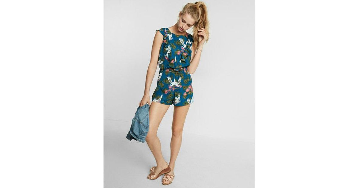 24a8576d283 Lyst - Express Petite Floral Print Ruffle Front Romper in Blue
