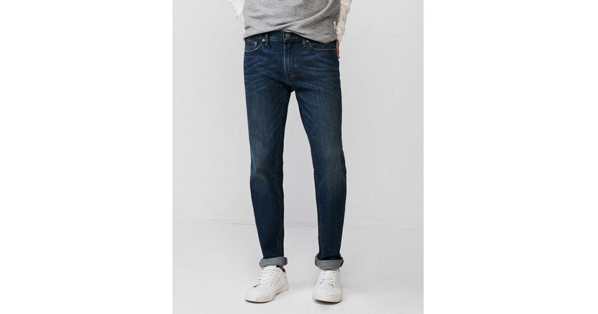 Lyst express slim dark wash soft cotton stretch jeans in for Express wash roma