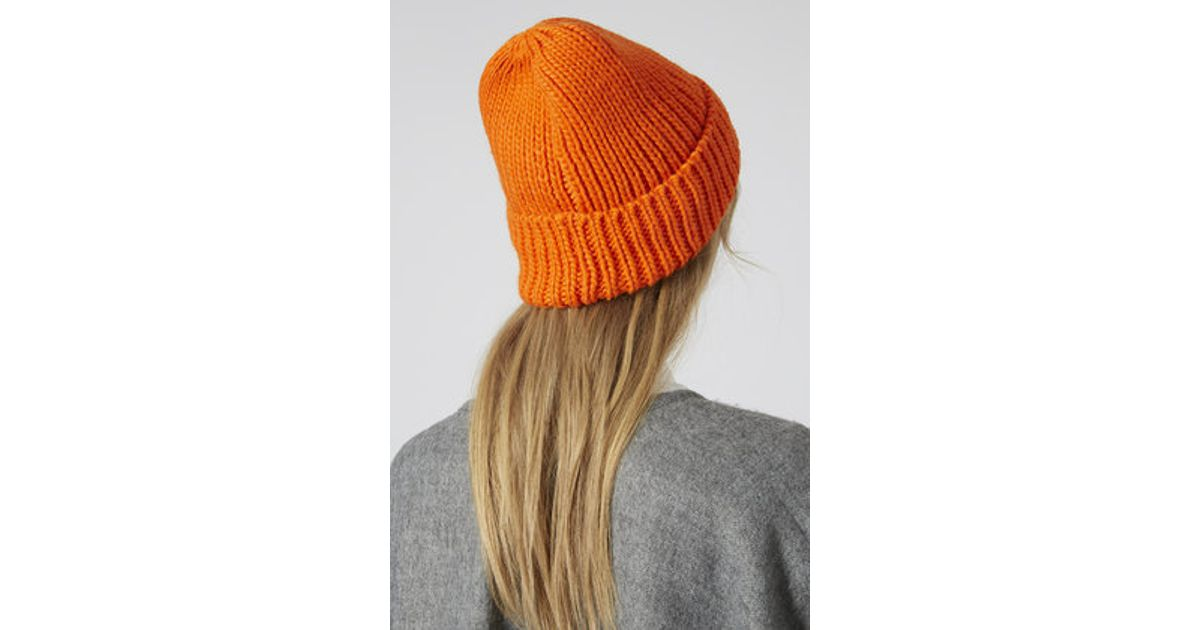 35e27a3b745ed Lyst - TOPSHOP Fisherman Beanie in Orange