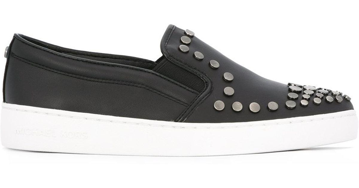 More Details Alexander McQueen Men's Studded Leather High-Top Sneakers, White/Black Details Alexander McQueen high-top sneaker in calfskin leather. Rounded silvertone metal stud details at contrast backstay. Round toe. Lace-up front. Logo detail at tongue. Padded collar. Oversized rubber platform outsole.