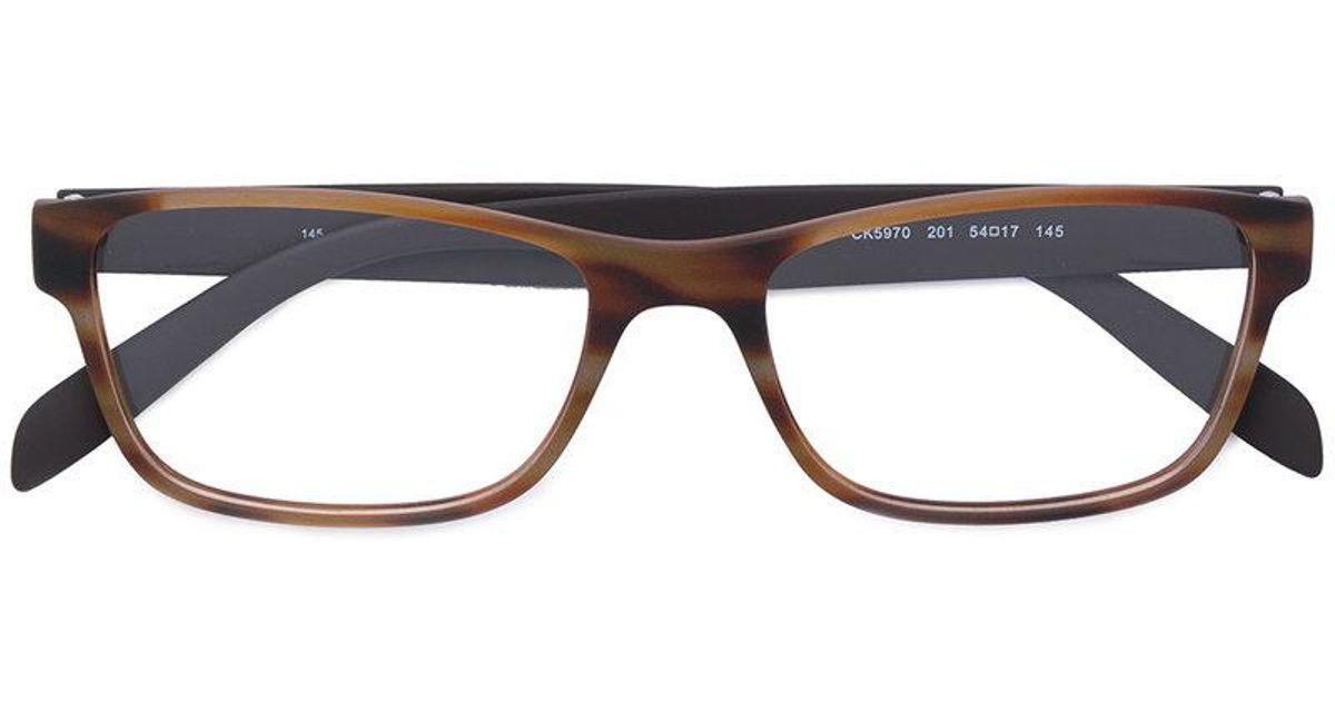 65703a3ce27441 Lyst - Lunettes à monture carrée Calvin Klein en coloris Marron
