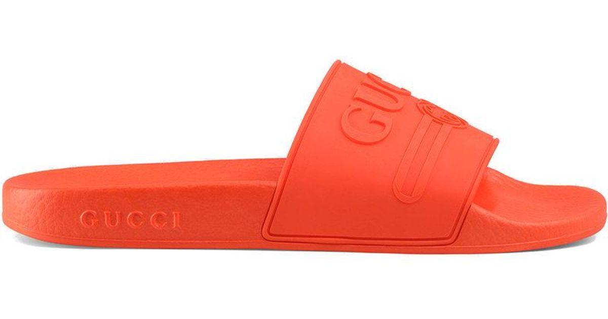 4ed137c1bc25 Lyst - Gucci Logo Rubber Slide Sandals