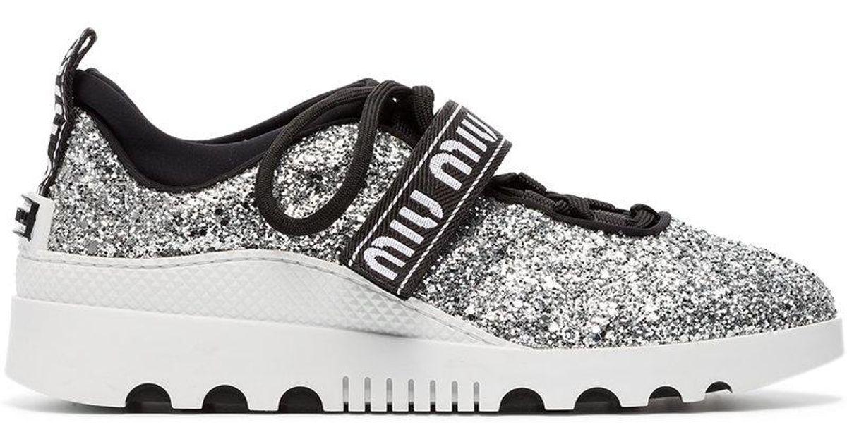 logo glitter lace-up sneakers - Metallic Miu Miu Fv56f