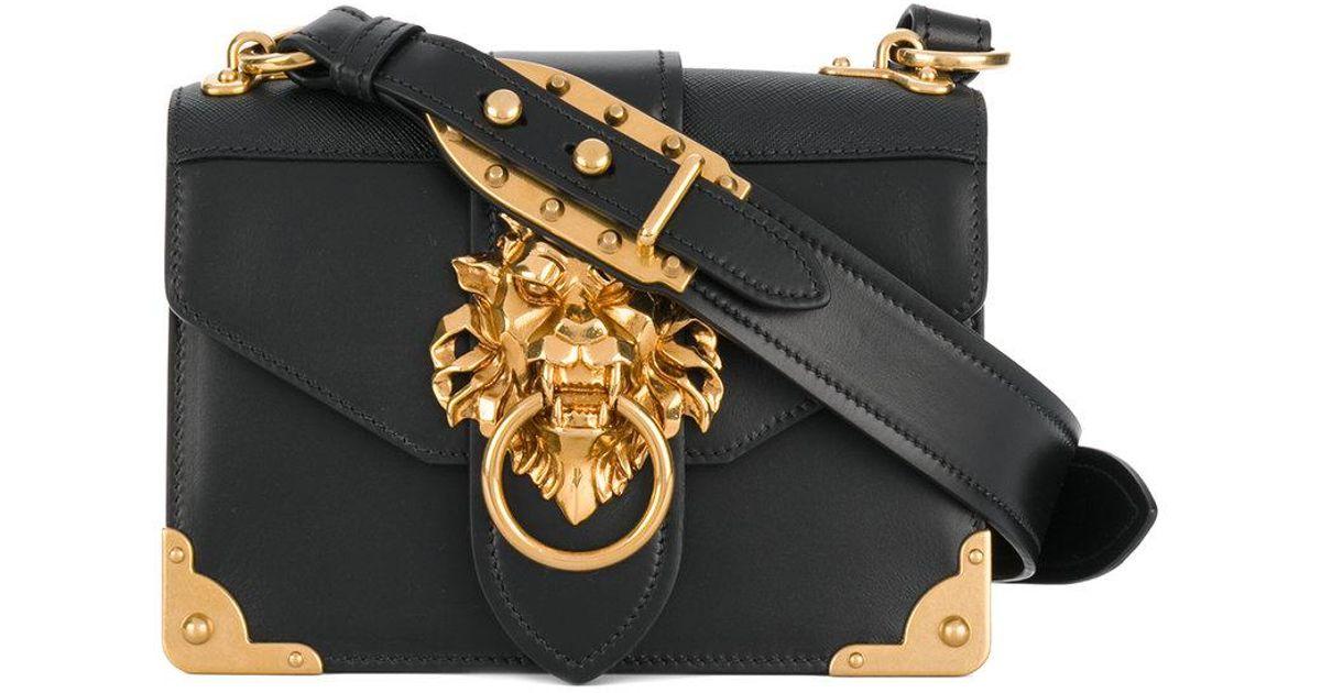 a1ff8d320bce ... wholesale lyst prada cahier lion embellished shoulder bag in black  1f5df 11f74