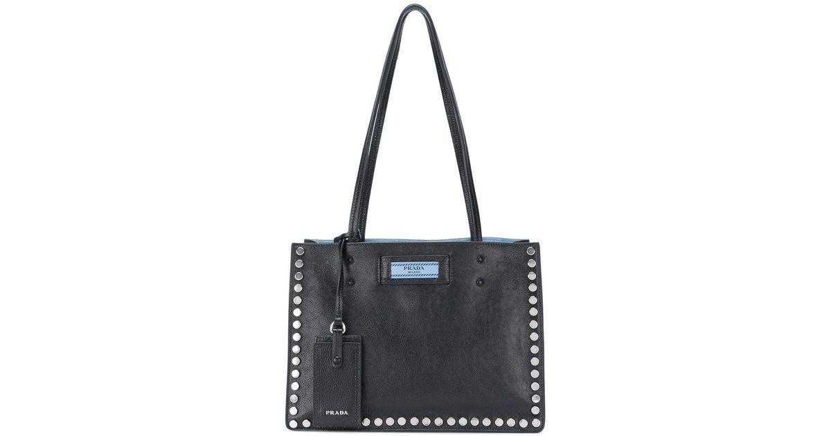 016bf764cb6b ... switzerland lyst prada etiquette studded tote bag in black fc65e ad0e2