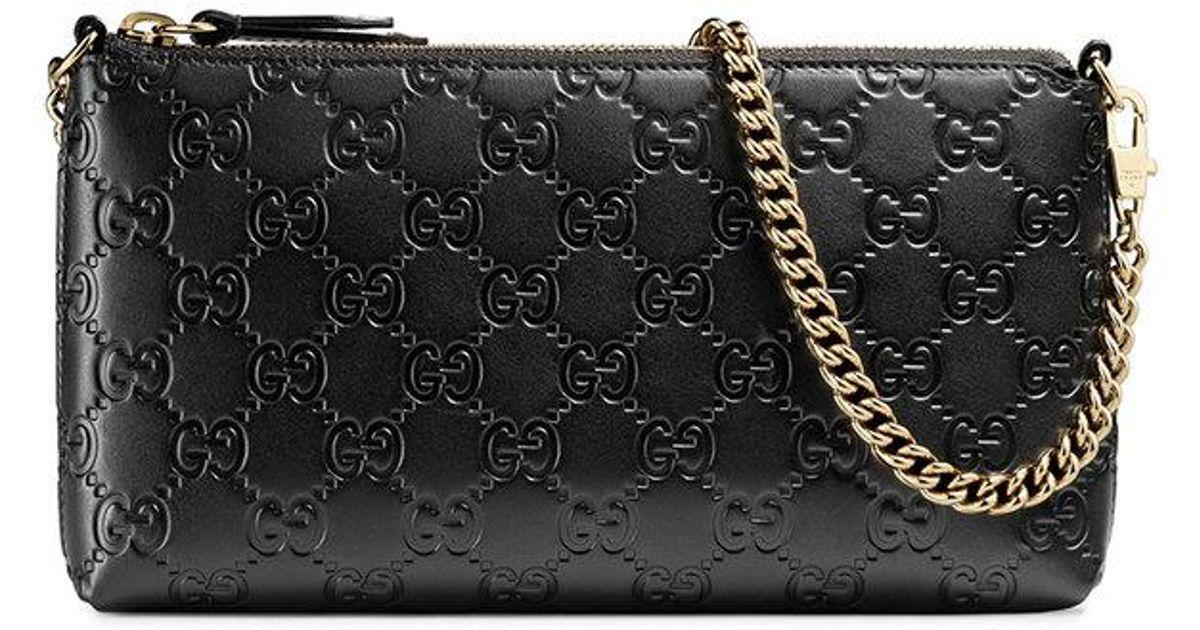0b59a2b9a16f Gucci Signature Wrist Wallet in Black - Lyst