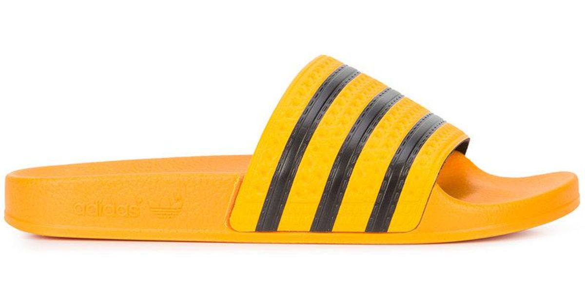 7b7b9d7a2 adidas yellow striped slides for men lyst .