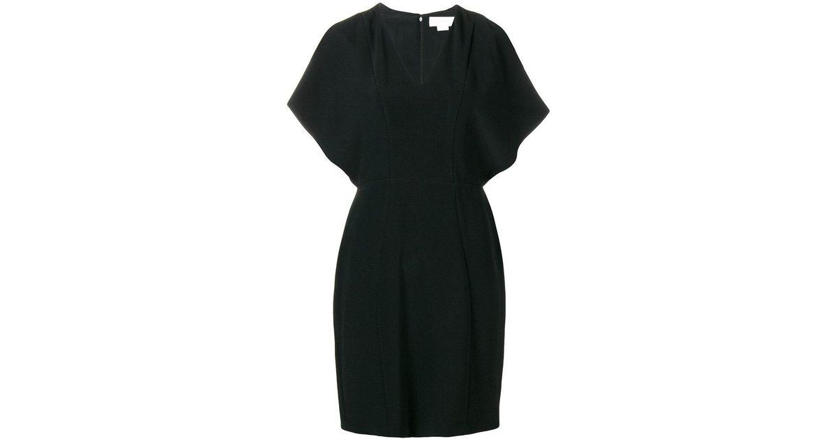 Lyst Genny Shoulderless Short Dress In Black