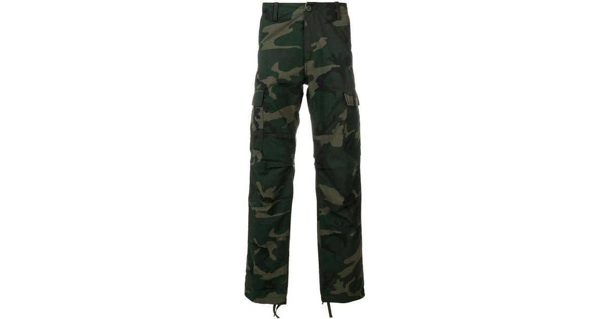 7c09c0a0c02 Lyst - Pantalones con estampado militar Carhartt de hombre de color Verde