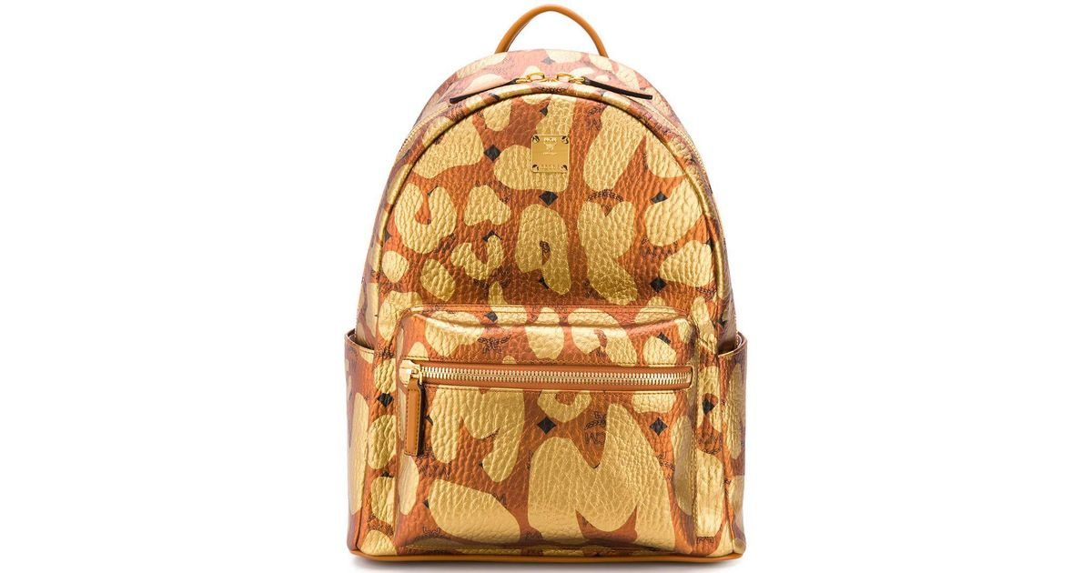 50a8707d6b01 MCM Stark Backpack In Leopard Print in Yellow - Lyst
