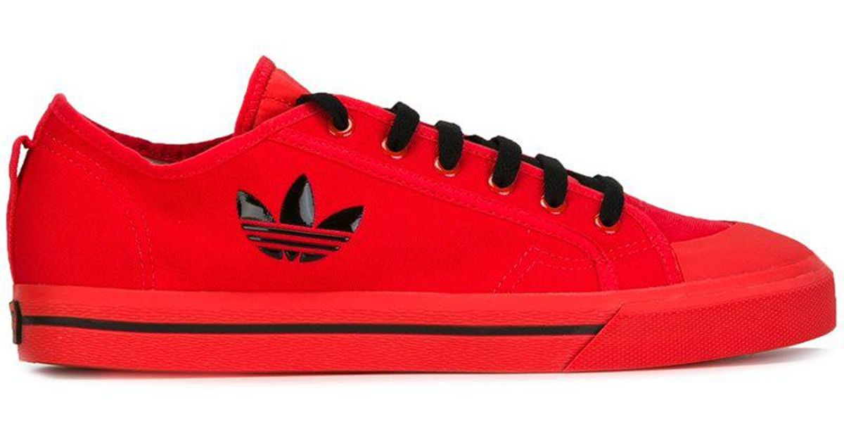 Adidas By Raf Simons logo lateral sneakers purchase cheap price 7yOrumol