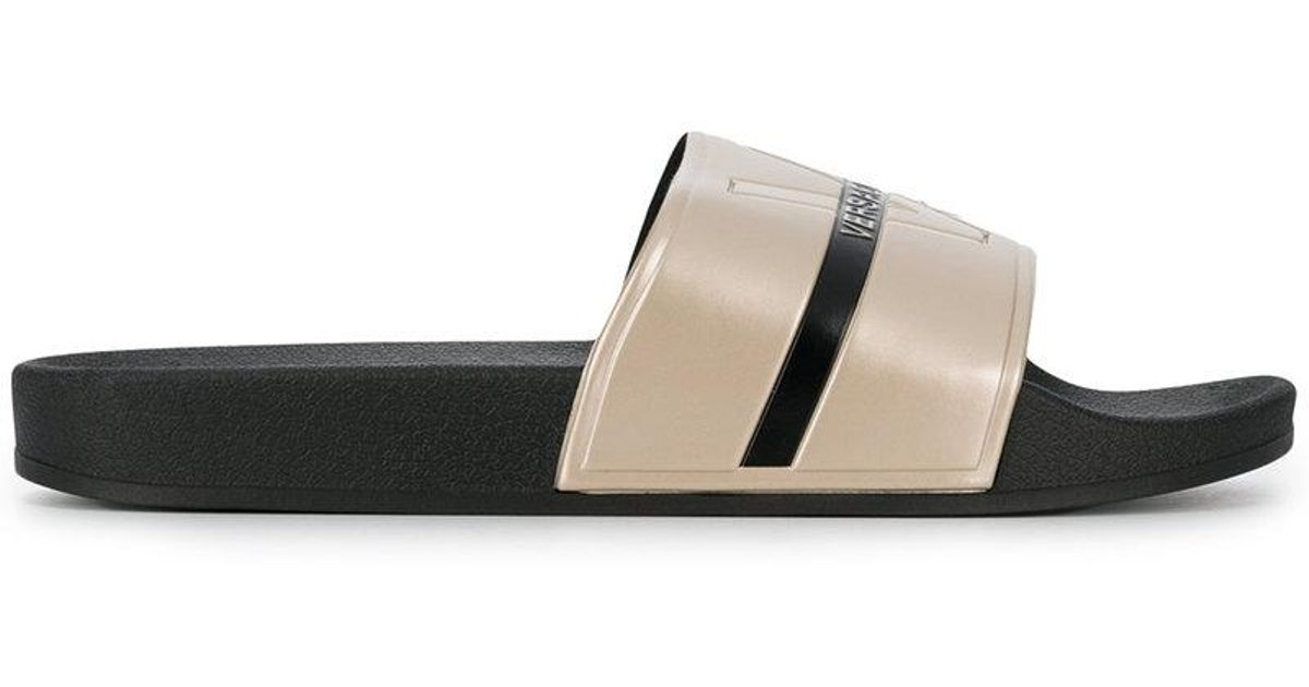 c2f0a1187 Lyst - Versace Jeans Striped Logo Embossed Slides in Black for Men