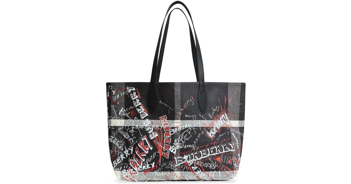 af7701880279 Lyst - Burberry The Medium Reversible Doodle Tote in Black