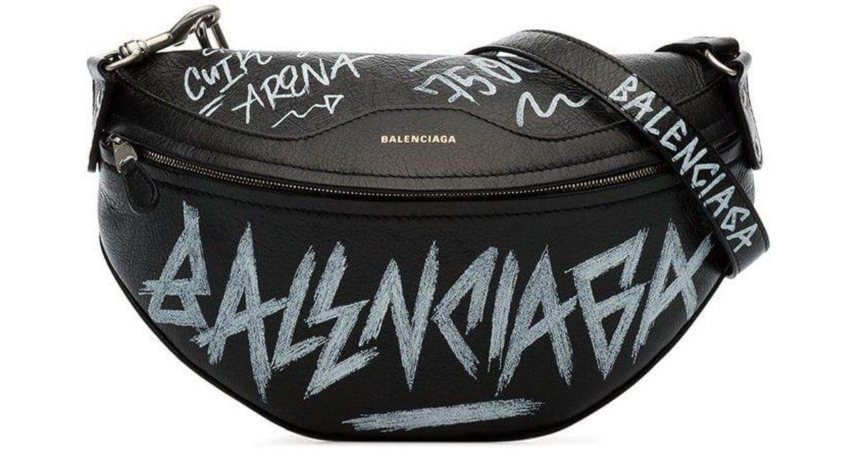 Lyst - Balenciaga Black And White Souvenir Xs Graffiti Leather Belt Bag in  Black a8cb84f718bed
