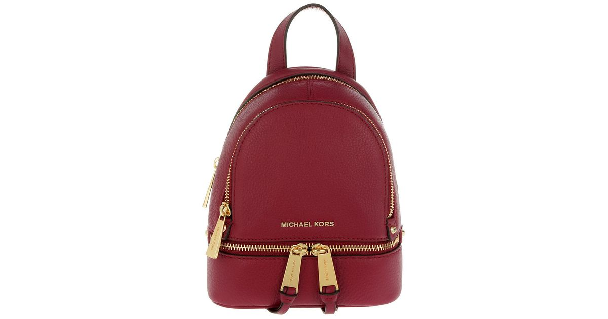 e3640410f5cd41 ... reduced michael kors rhea zip xs messenger backpack mulberry in red  lyst ea0c2 04d4d