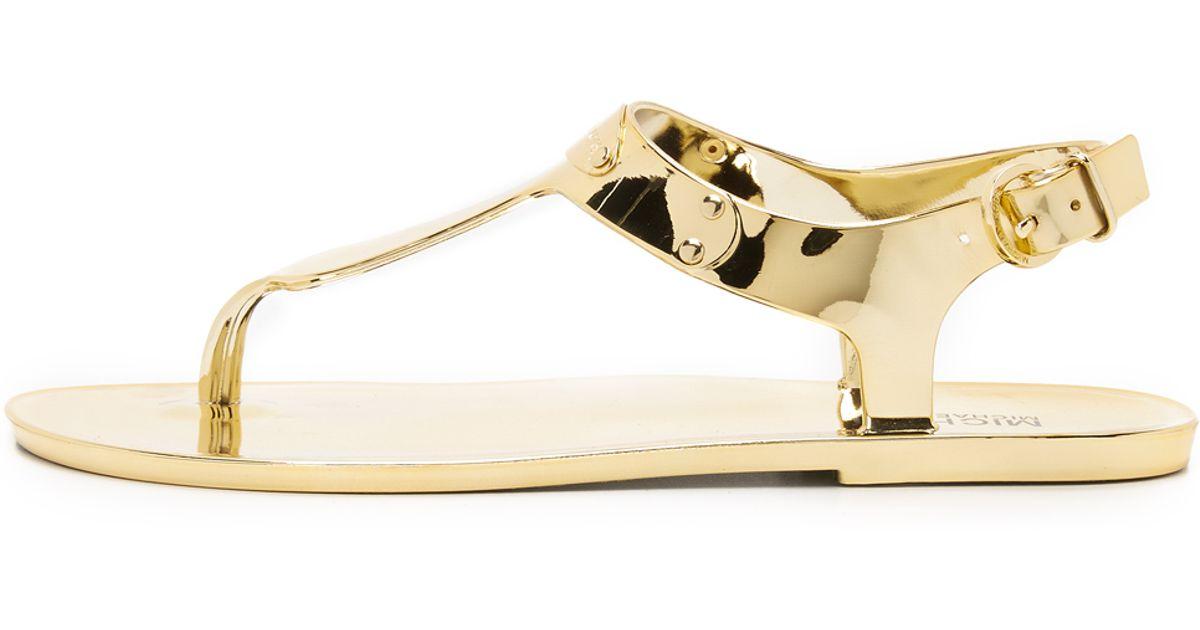 bb995ddfe71 MICHAEL Michael Kors Mk Plate Jelly Sandals - Gold in Metallic - Lyst