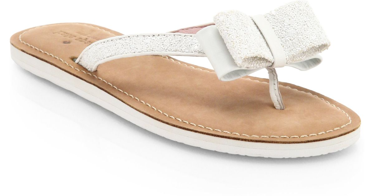 10894f939 Lyst - Kate Spade Icarda Glittered Leather Bow Thong Sandals in White