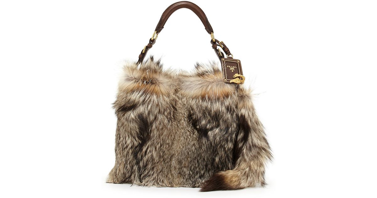 3f2fb472ac0 Lyst - Prada Fox Fur Hobo Bag in Brown