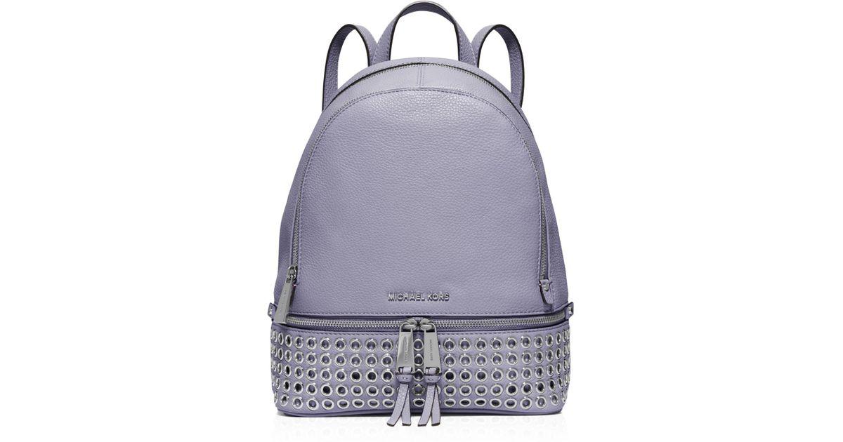 10dd3a83768968 ... purchase michael michael kors medium rhea zip grommet backpack in  purple lyst e16b1 a1202