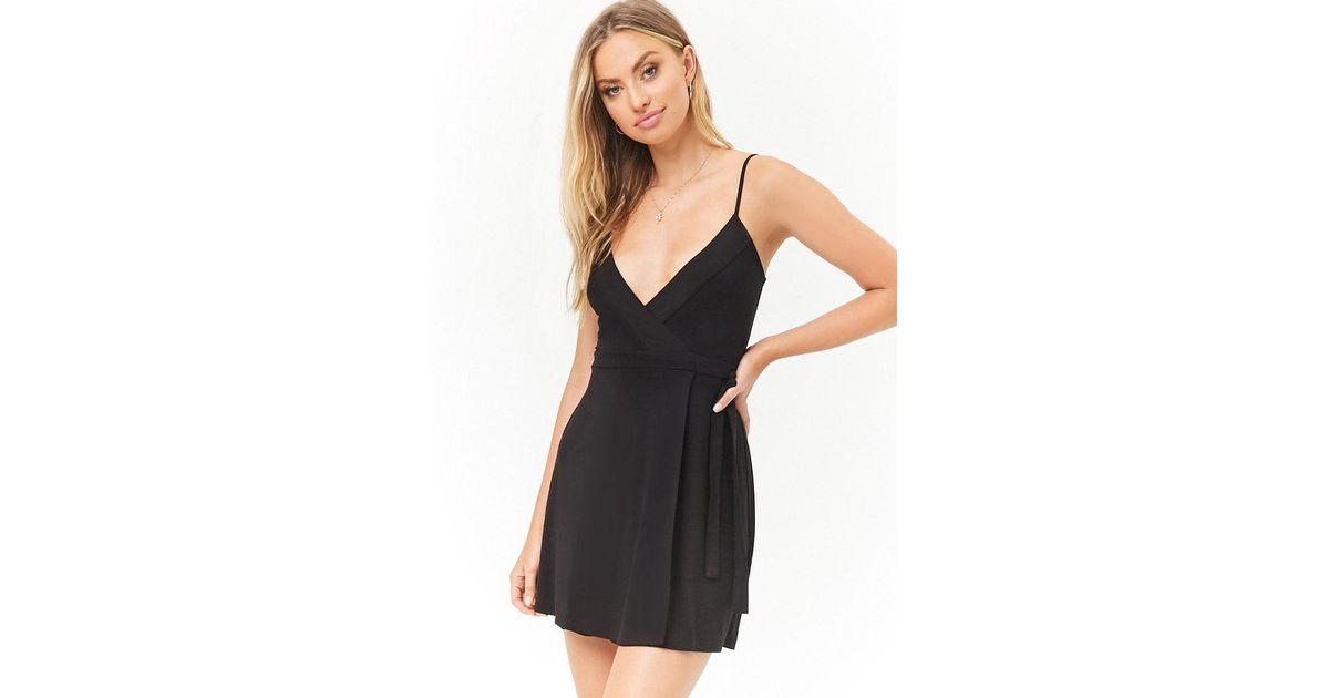 6ce136d3e93 Lyst - Forever 21 Women s Surplice Cami Mini Wrap Dress in Black