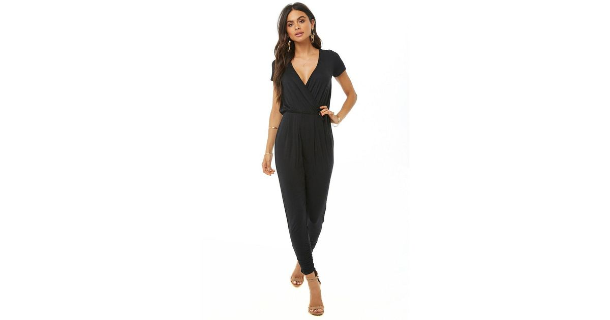 5781881aa6b92 Forever 21 Mock Wrap Ruched Jumpsuit in Black - Lyst