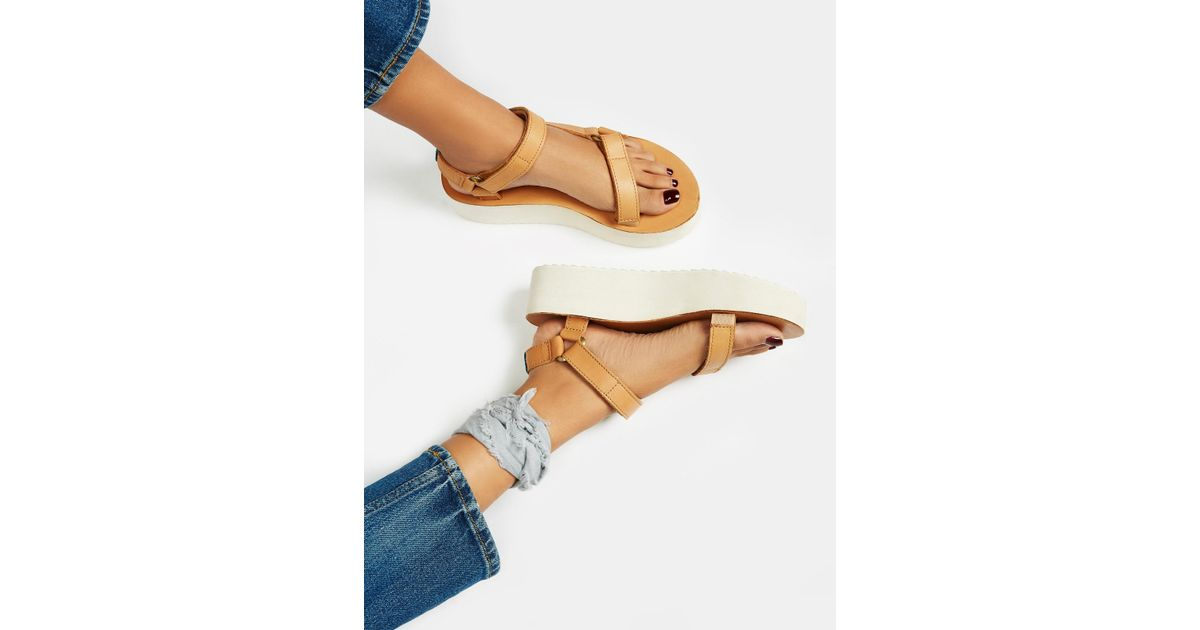 16688f8768df Free People Flatform Universal Crafted Teva in Blue - Lyst