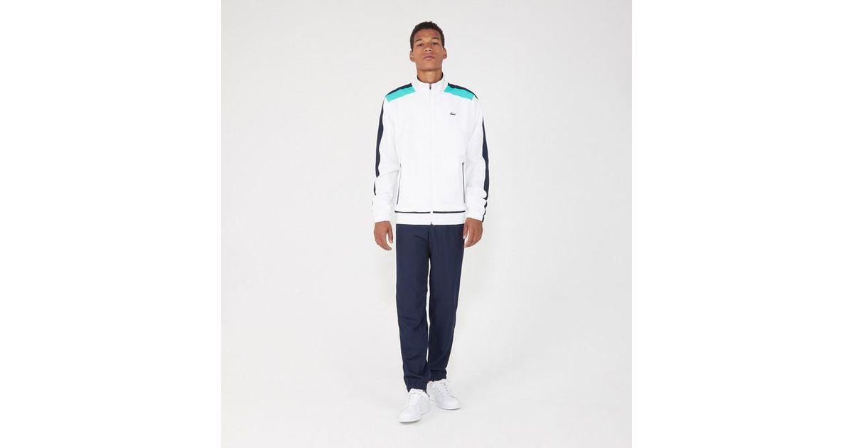 d0dca1345e Ensemble survêtement veste et jogging Lacoste pour homme en coloris Blanc -  Lyst