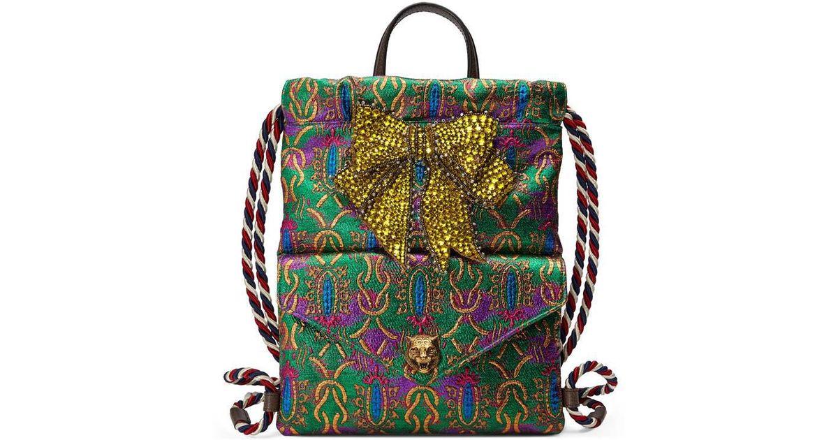 f8d5760cd122 Lyst - Gucci Crystal Bow Brocade Drawstring Backpack