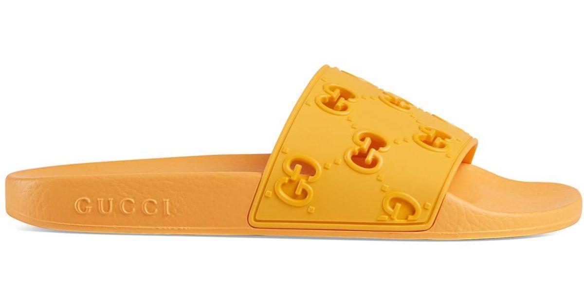 9627c5112115 Gucci Women's Rubber GG Slide Sandal - Lyst
