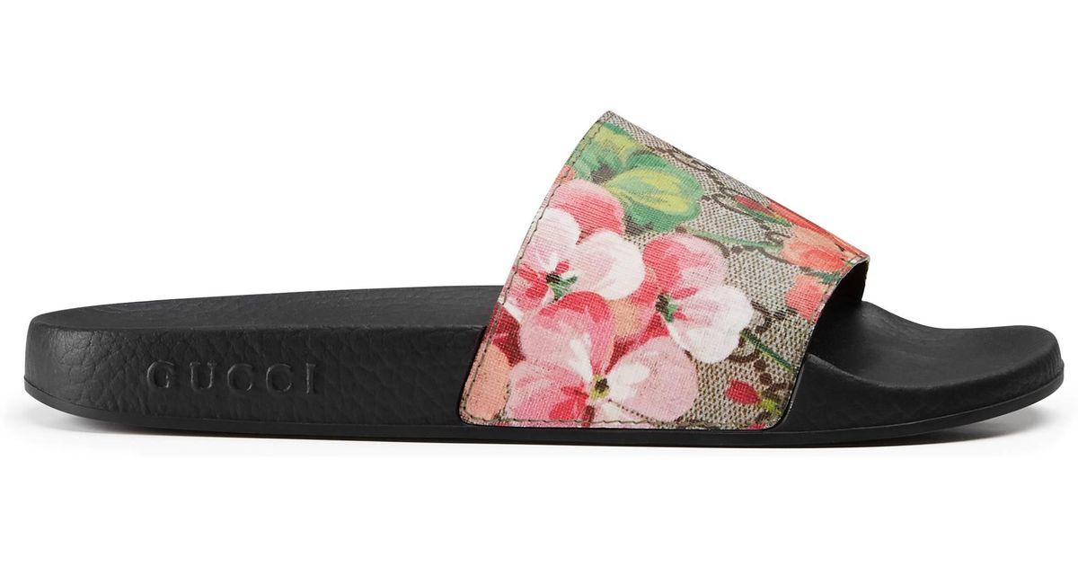 59d3422c2e78 Gucci. Women s Blooms Supreme Canvas Slides