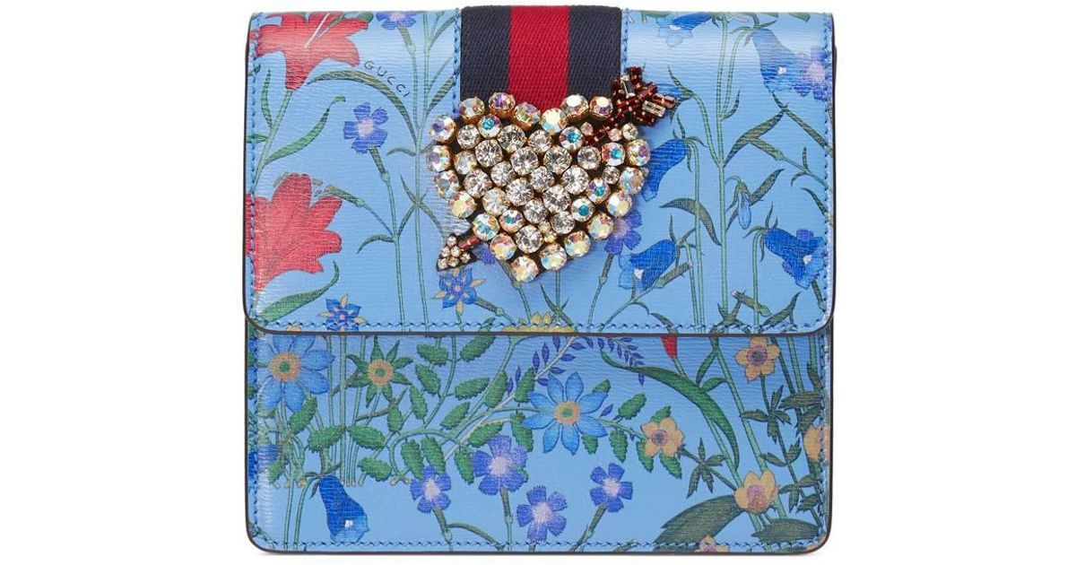 8aacf7dcfce Lyst - Gucci Totem New Flora Print Leather Clutch in Blue