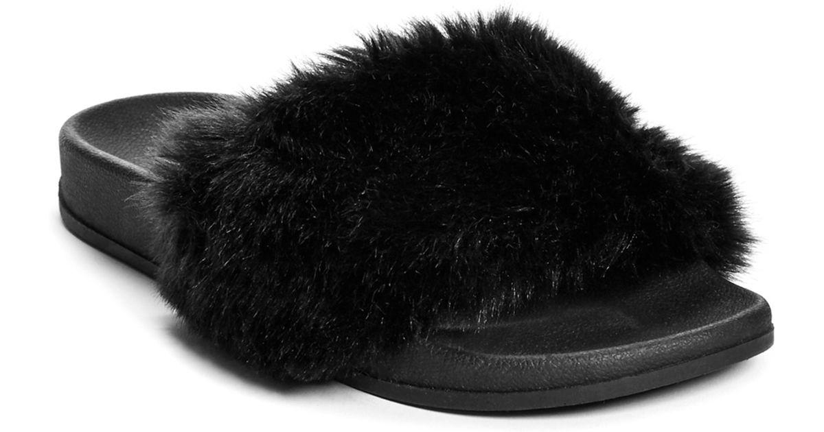 3d1163a8deb Guess Buffie Faux-fur Slide Sandals in Black - Lyst