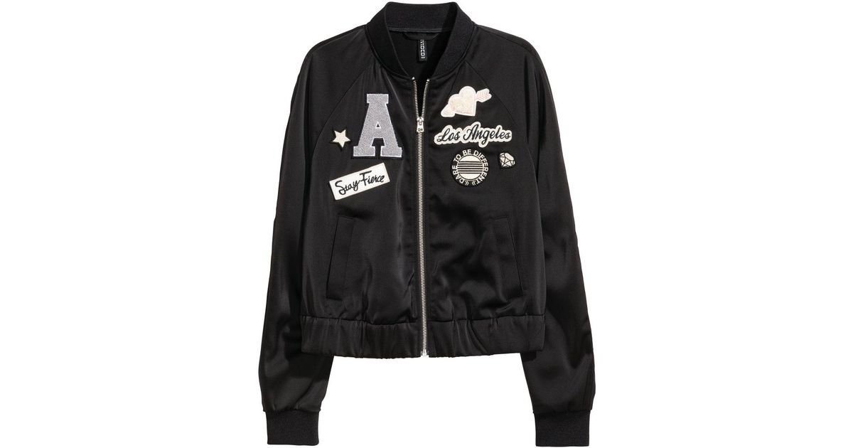 Lyst h m bomber jacket with appliqués in black