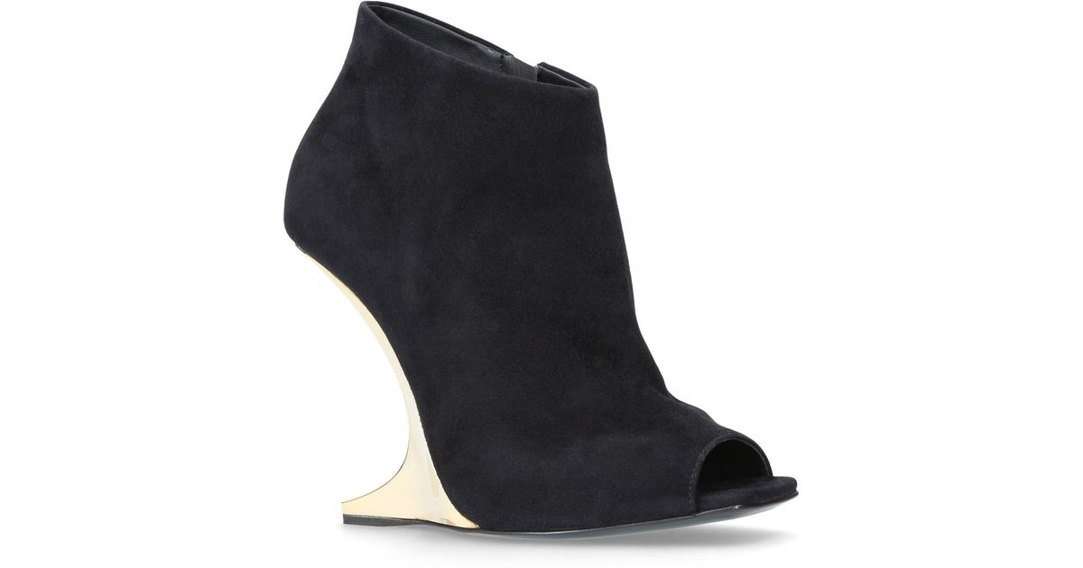 30ac4776f1907 Lyst - Giuseppe Zanotti Picard Gold Ankle Boots in Black