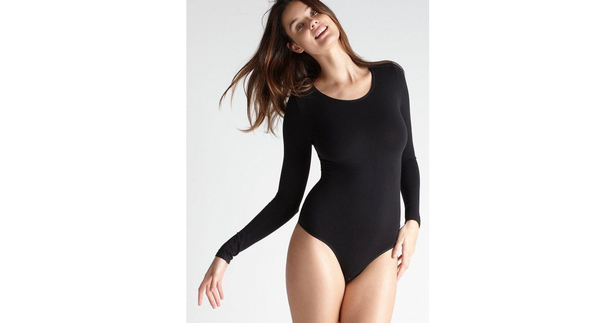 7db7ee3f5abe Yummie Long Sleeve Thong Bodysuit In Black, White in Black - Lyst