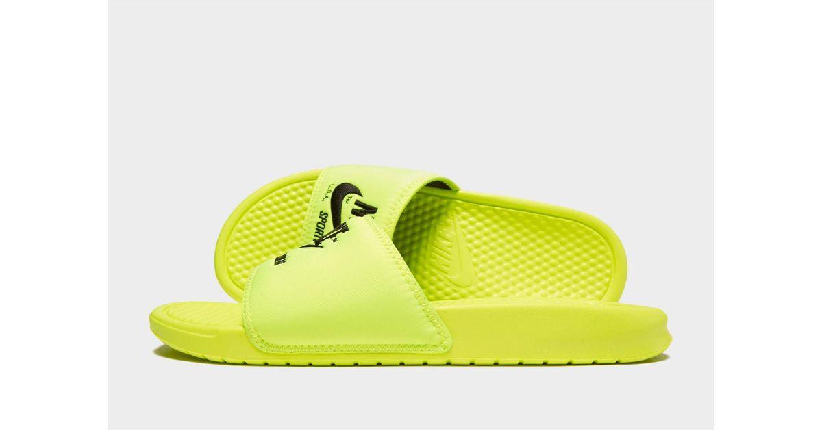 61a8e4e7effd Lyst - Nike Sportswear Benassi Text Slides in Yellow for Men