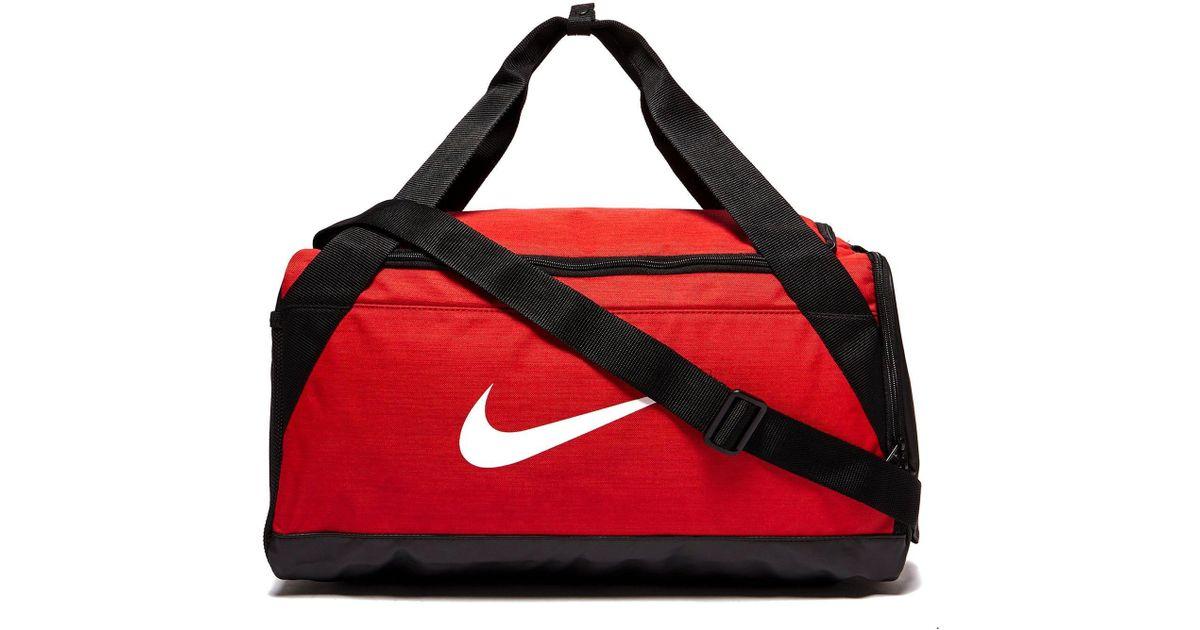 c93b749f33 Lyst - Nike Small Brasilia Bag in Red for Men
