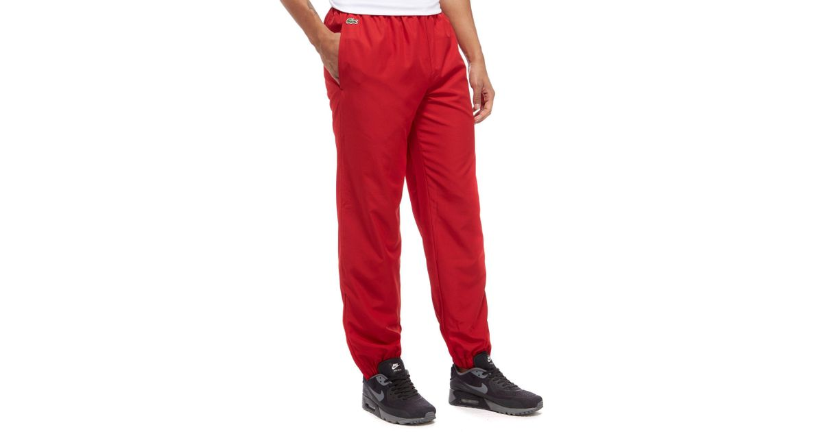 41fb3437e3 Lacoste Guppy Track Pants in Red for Men - Lyst