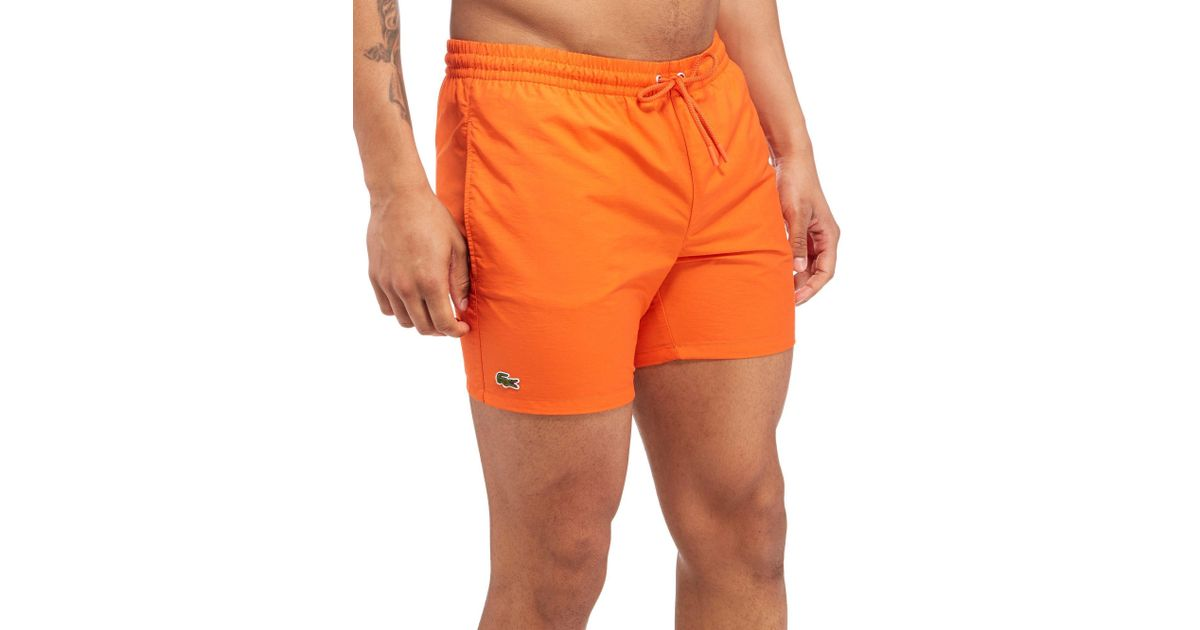 f613d2ef5638a Lyst - Lacoste Swim Shorts in Orange for Men