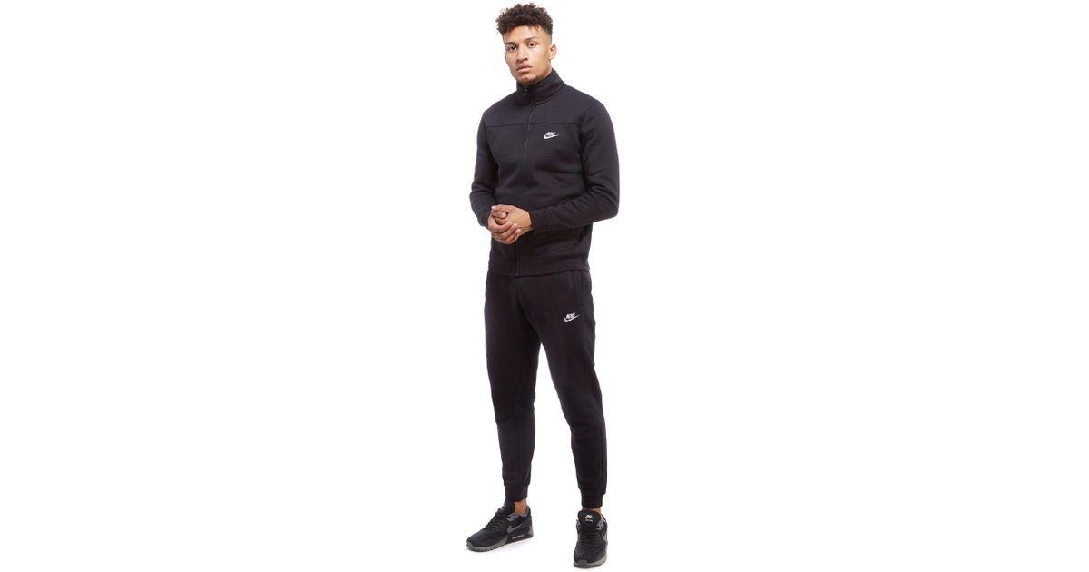 5145df91b9 ... pretty nice cc2b5 3088f Nike Season 2 Fleece Tracksuit in Black for Men  - Lyst ...